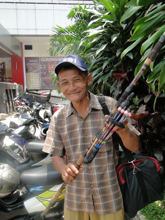 Man selling a blowgun