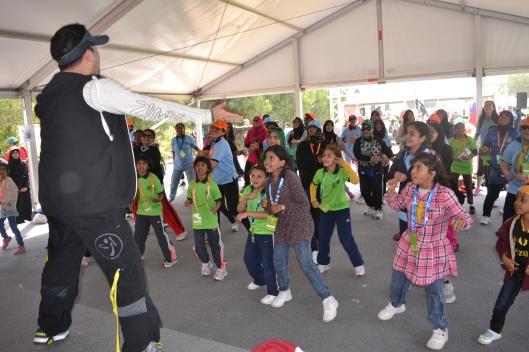 Jamil conducting a Kids Zumba class